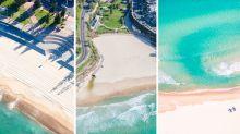 'Eerily beautiful:' Images show iconic Sydney beaches completely empty