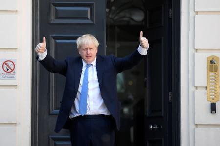 Boris Johnson arrives at the Conservative Party headquarters in London