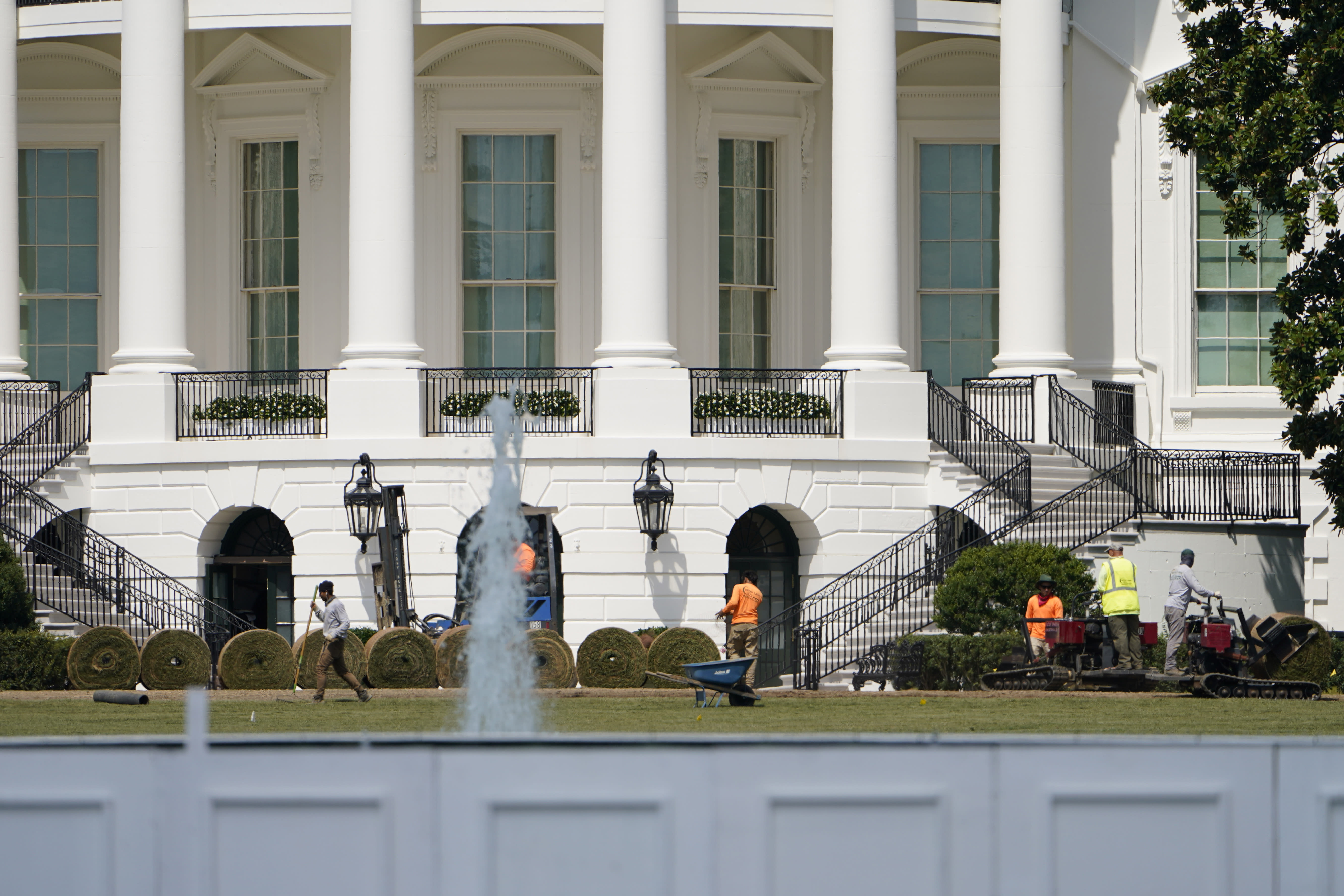 Workers lay sod on the South Lawn of the White House, Tuesday, Sept. 8, 2020, in Washington. The White House South Lawn and its iconic Rose Garden are undergoing extensive re-sodding and other work after last month's Republican National Convention turned them into a muddy mess. Crews have been working to repair damage to the public grounds, including browning of the South Lawn and mud patches in the Rose Garden, after the spaces were used as backdrops for President Donald Trump's convention events. (AP Photo/Jacquelyn Martin)