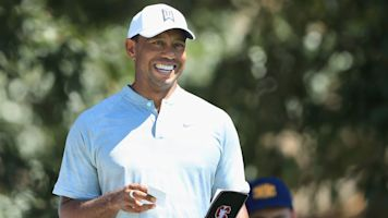 Tiger enters weekend tied for first with Rose