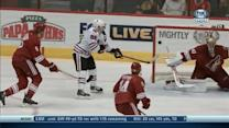 Patrick Kane deflects one past Mike Smith