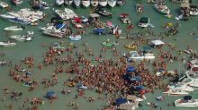 A crowded lake party with hundreds of people has been linked to an outbreak of coronavirus in Michigan