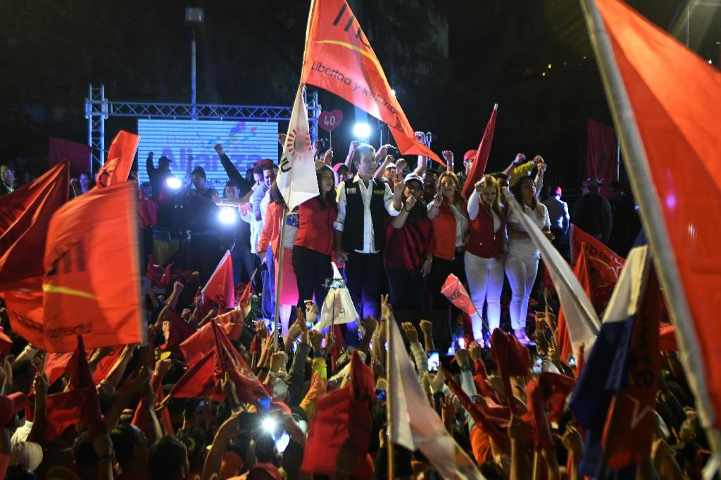 Salvador Nasralla, an opposition presidential candidate in Honduras, greets supporters during a rally in the capital Tegucigalpa