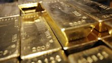 Gold prices see subdued rise, buoyed by weaker dollar as stocks rally