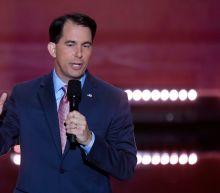 Wisconsin Gov. Scott Walker signs lame-duck legislation that curbs his Democratic successor's authority