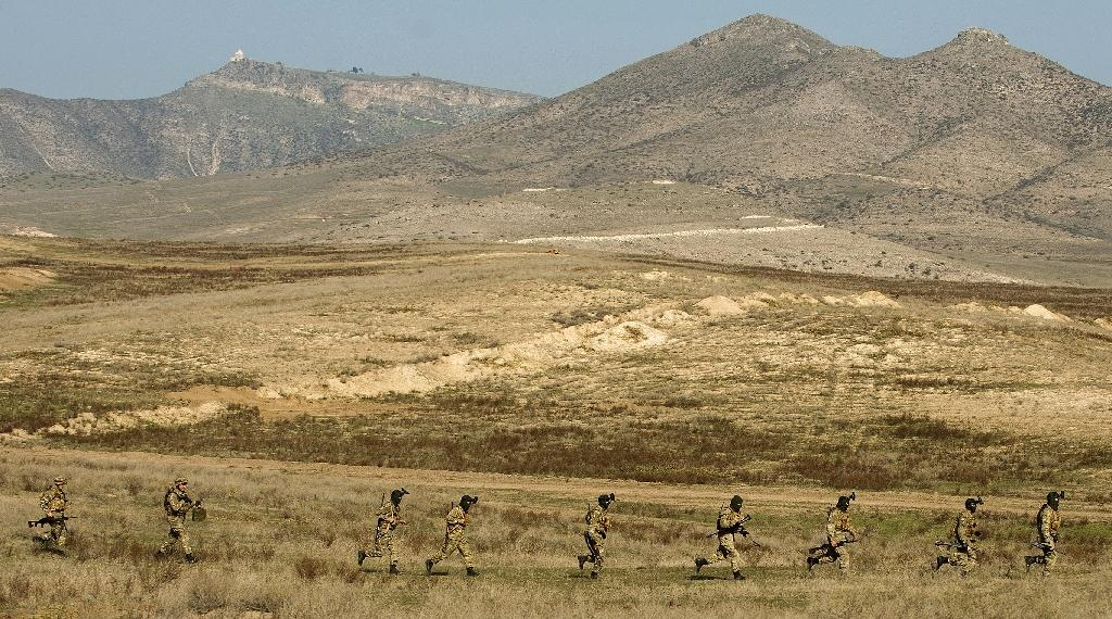 Armenian and Karabakh armed forces hold joint military exercises near the town of Tigranakert in November 2014 (AFP Photo/Karen Minasyan)