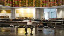 Global shares mixed as investors watch trade talks