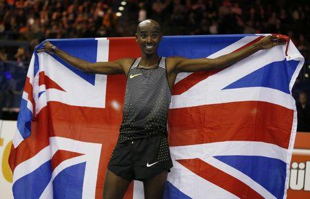 FILE PHOTO - Great Britain's Mo Farah celebrates winning the Men's 5000m