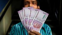 Indian rupee cracks below 66-level in free fall, plunges 32 paise vs USD