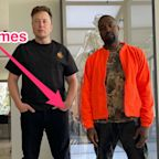 A reflection in a photo of Elon Musk and Kanye West appears to show Grimes taking the picture