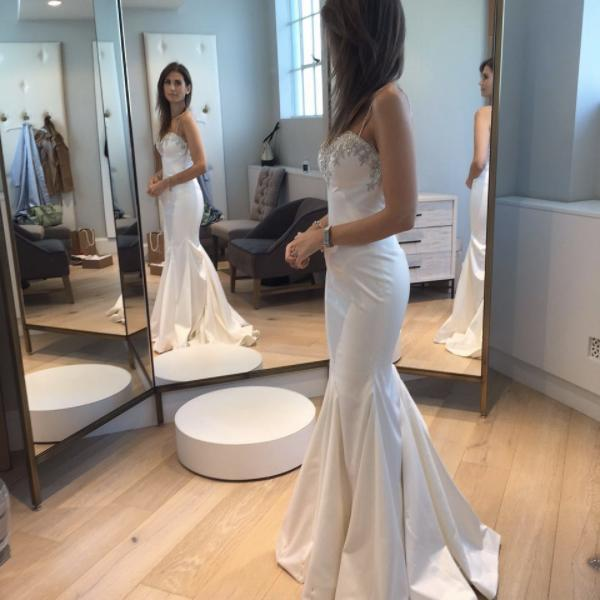 """<p>""""#tbt to trying on my @pninatornai #weddingdress last year before the big day! Can't believe I've already been married for almost a year! Time flies when you're in love.""""<em>(Photo via: <a href=""""https://www.instagram.com/p/BR38W8gl78T/?taken-by=jessgrossman"""" rel=""""nofollow noopener"""" target=""""_blank"""" data-ylk=""""slk:Instagram/jessgrossman"""" class=""""link rapid-noclick-resp"""">Instagram/jessgrossman</a>)</em> </p>"""