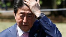 Voter support for Japan's Abe slips amid calls for finance minister to quit