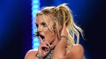 Watch a Britney Spears Fan Rush Stage at Concert, Get Tackled by Security (Video)