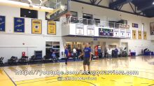 Stephen Curry punts a basketball in the net from long range