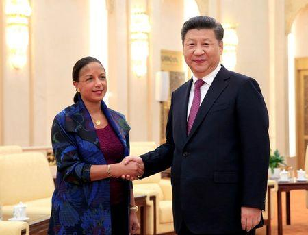US National Security Adviser Susan Rice shakes hands with Chinese President Xi Jinping during their meeting at the Great Hall of the People in Beijing