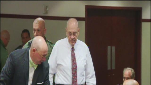 Accused theater shooter appears in court