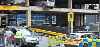 Vehicles left dangling after part of car park collapses