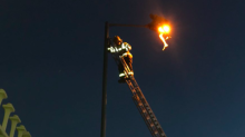 Man who 'may have taken illegal high' is rescued from top of lamppost by firefighters