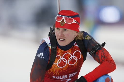FILE - In this Friday, Feb. 21, 2014 file photo, Russia's Yana Romanova during the women's biathlon 4x6k relay, at the 2014 Winter Olympics, in Krasnaya Polyana, Russia. Two-time Olympic biathlon champion Olga Zaitseva lost her appeal Thursday Sept. 24, 2020, against disqualification from the 2014 Sochi Olympics for her part in Russias state-backed doping program and two of Zaitsevas relay teammates at Sochi, Olga Vilukhina and Yana Romanova, won their appeals and had their IOC disqualifications from individual biathlon events at Sochi overturned. (AP Photo/Dmitry Lovetsky, File)
