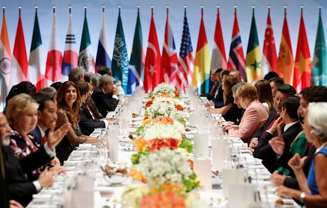 """Leaders attend the G-20 summit dinner in Hamburg, Germany, on Friday. The pope criticized the U.S. and Russia, among other countries, for having a """"distorted vision of the world."""" (Axel Schmidt / Reuters)"""