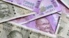 Rupee falls 43 paise to settle at a record low of 76.87 against US dollar