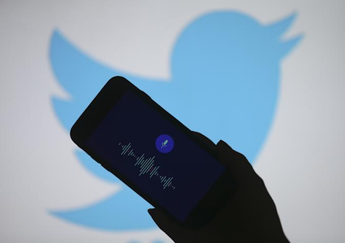 ANKARA, TURKEY - JUNE 28: In this photo illustration, recording voice tweet feature of Twitter is displayed on a smart phone screen in front of a laptop screen displaying logo of Twitter in Ankara, Turkey on June 28, 2020. (Photo by Dogukan Keskinkilic/Anadolu Agency via Getty Images)