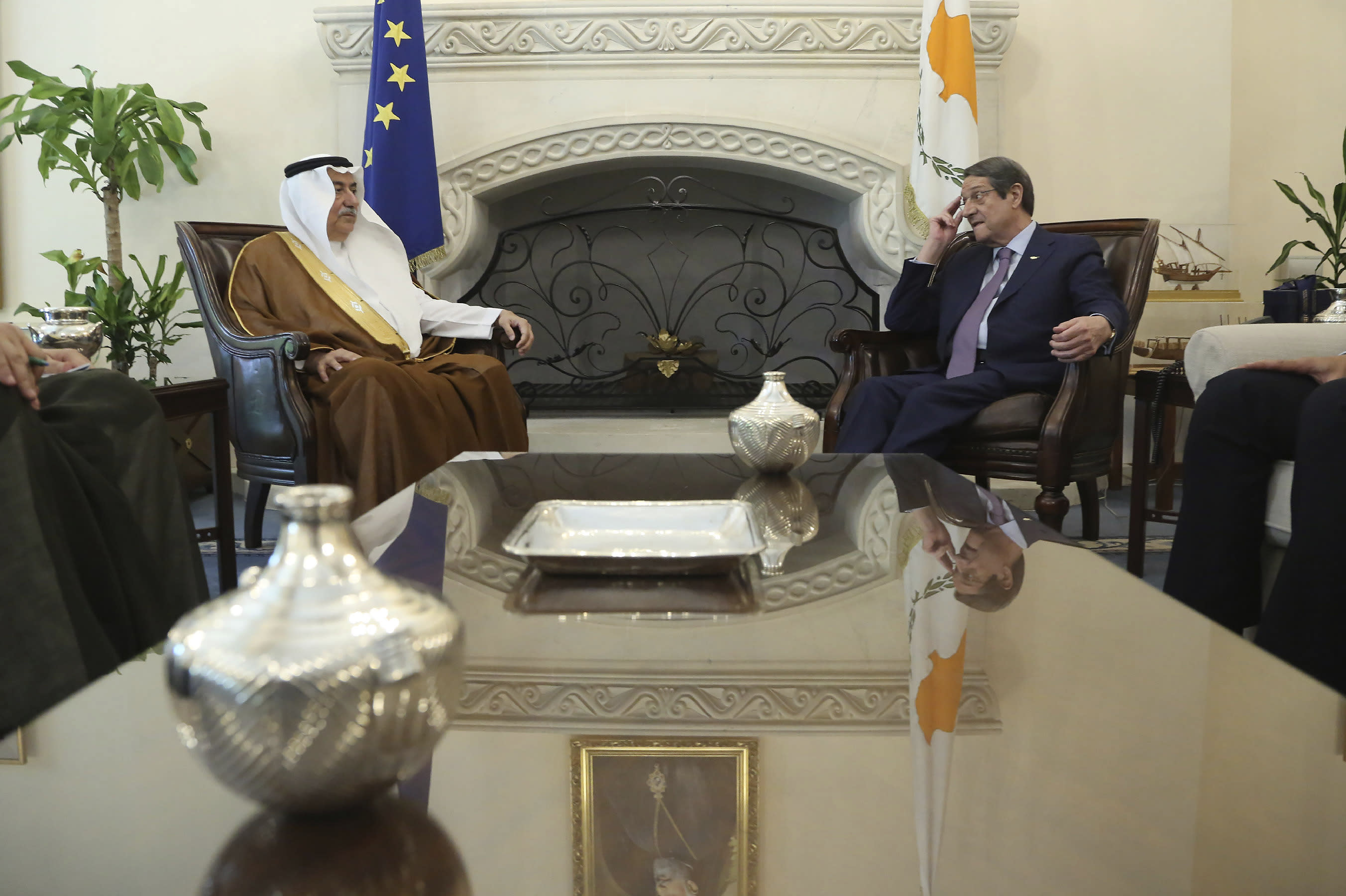Cyprus' president Nicos Anastasiades, right, and Saudi Foreign Minister Ibrahim Bin Abdulaziz Al-Assaf talk during their meeting at the presidential palace in capital Nicosia, Cyprus, Wednesday Sept. 11, 2019. Al-Assaf is in Cyprus for talks. (AP Photo/Petros Karadjias)