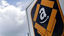 Amazon Pledges One-Day Delivery for Top Clients Starting in U.S.