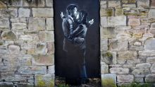 Banksy breaks cover to save cash-strapped youth club with £2 million 'Mobile Lovers' work