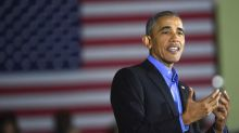 Obama blasts 'politics of division' on return to campaign trail