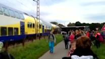 Train ploughs into evacuated school bus: video