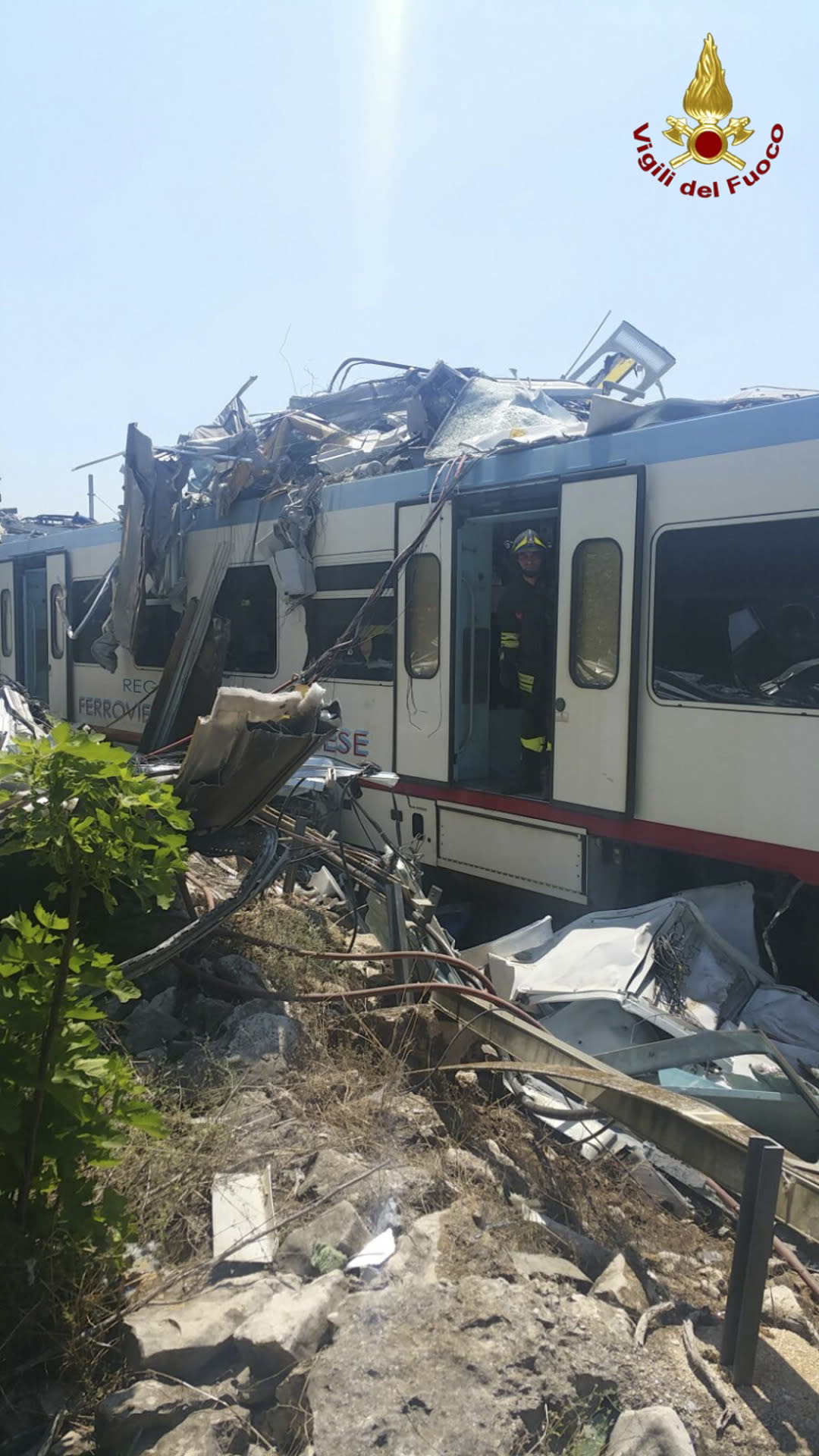 <p>The wreckage of a crumpled wagon at the scene of a train accident after two commuter trains collided head-on in the southern region of Puglia, killing several people, Tuesday, July 12, 2016. (Italian Firefighter Press Office via AP) </p>
