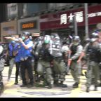 Tension in Hong Kong as projectile-hurling protesters force riot police to retreat