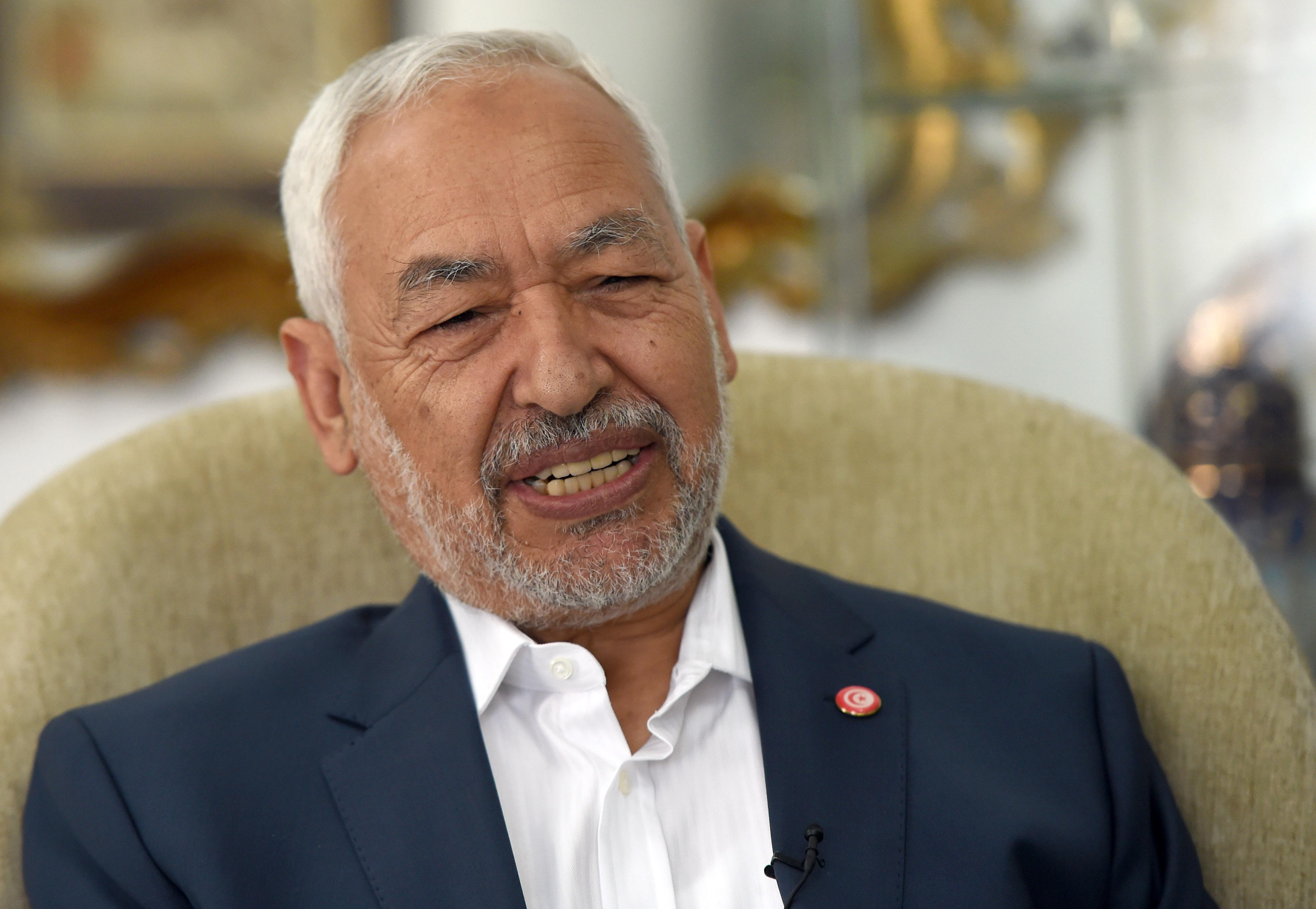 Ennahda Party leader Rached Ghannouchi answers AFP journalists' questions during an interview in Tunis, on October 22, 2014 (AFP Photo/Fethi Belaid)