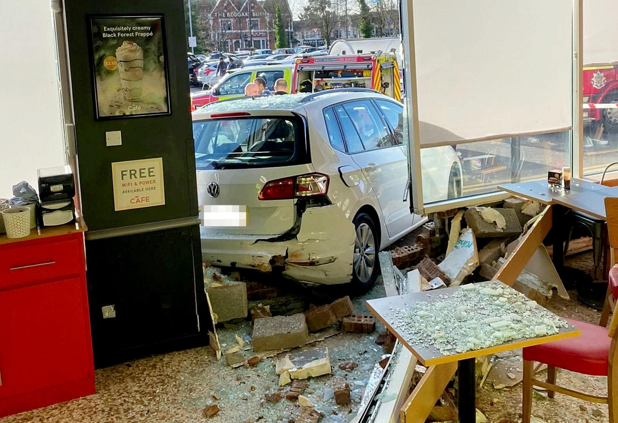 Man, 22, hospitalised after elderly driver crashes through Tesco cafe window