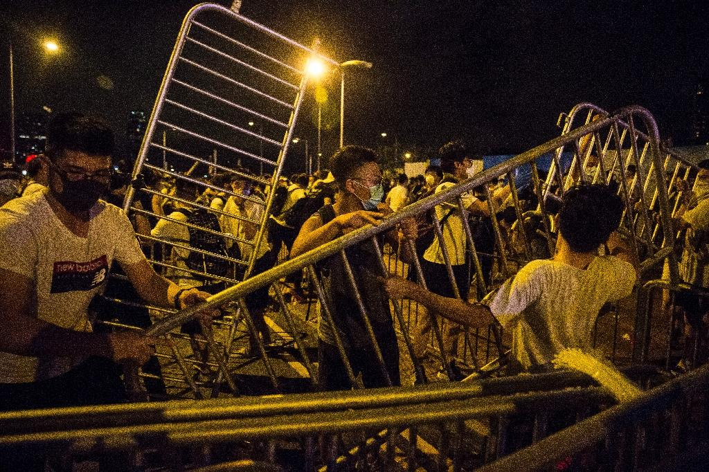 Hong Kong protesters blocked roads with barricades during clashes with police early Monday after a rally against a proposed extradition law proposal (AFP Photo/ISAAC LAWRENCE)