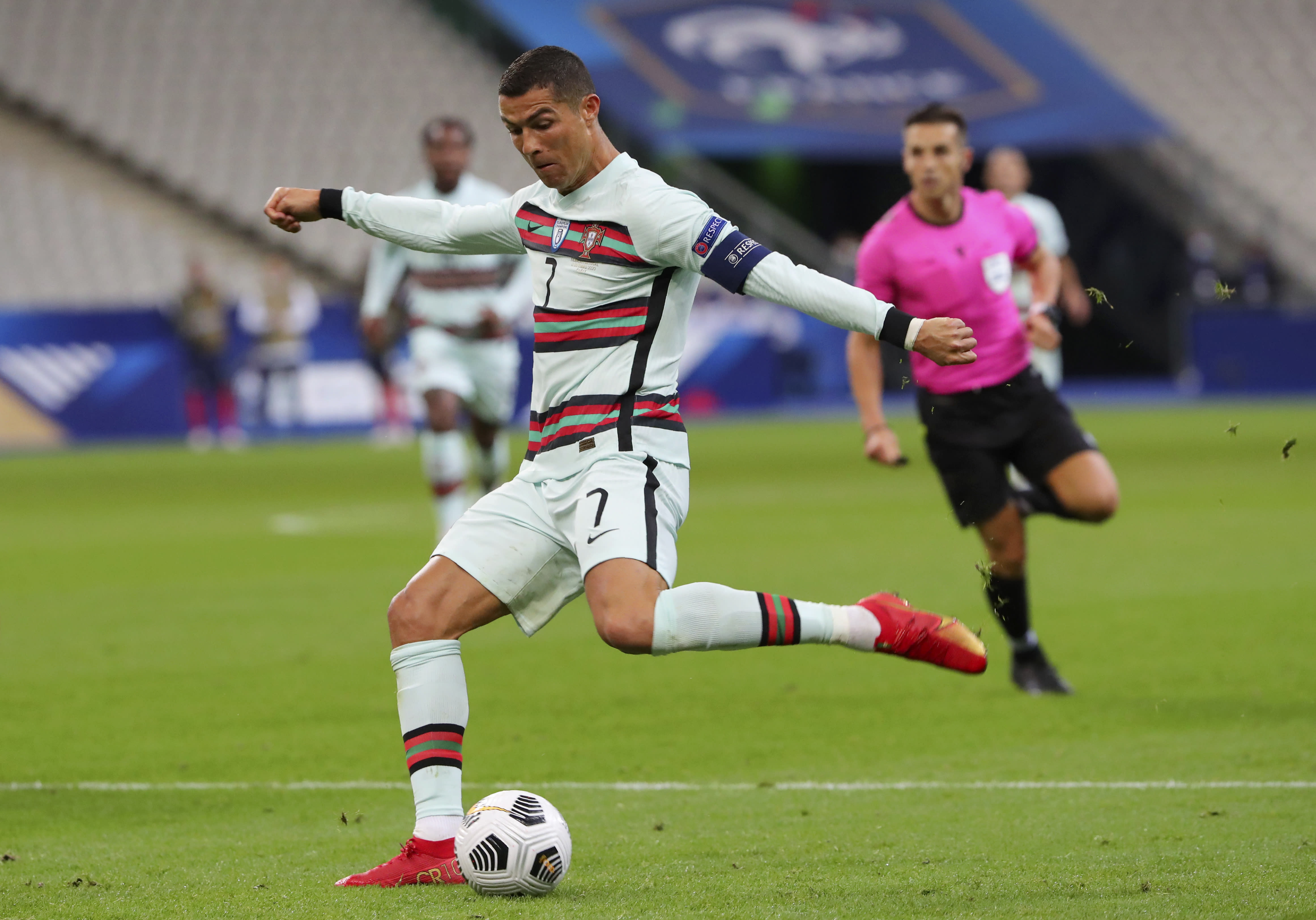 FILE - In this Sunday, Oct. 11, 2020 file photo Portugal's Cristiano Ronaldo attempts a shot at goal during the UEFA Nations League soccer match between France and Portugal at the Stade de France in Saint-Denis, north of Paris, France. The Portuguese soccer federation says Cristiano Ronaldo has tested positive for the coronavirus. The federation says Ronaldo is doing well and has no symptoms. He has been dropped from the country's Nations League match against Sweden on Wednesday. (AP Photo/Thibault Camus, File)