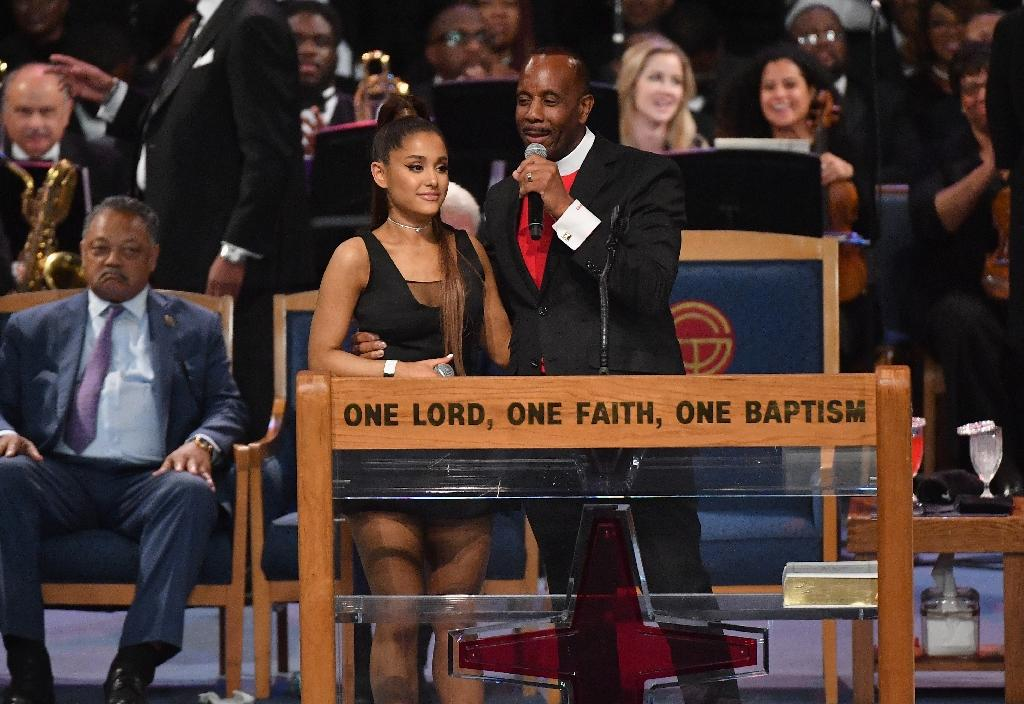 After her performance, Ariana Grande was congratulated by Bishop Charles H. Ellis III, who placed his arm high above her waist with his fingers pressed against her chest (AFP Photo/Angela Weiss)