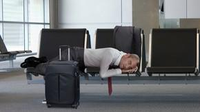 Sleeping Middle-Aged Businessman In Airport Suddenly So Childlike, So Vulnerable