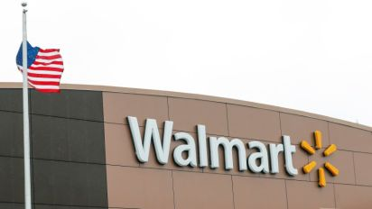 Walmart holiday quarter profit falls