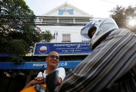 Men stand in front of the Cambodia National Rescue Party (CNRP) headquarters in Phnom Penh, Cambodia, November 17, 2017. REUTERS/Samrang Pring