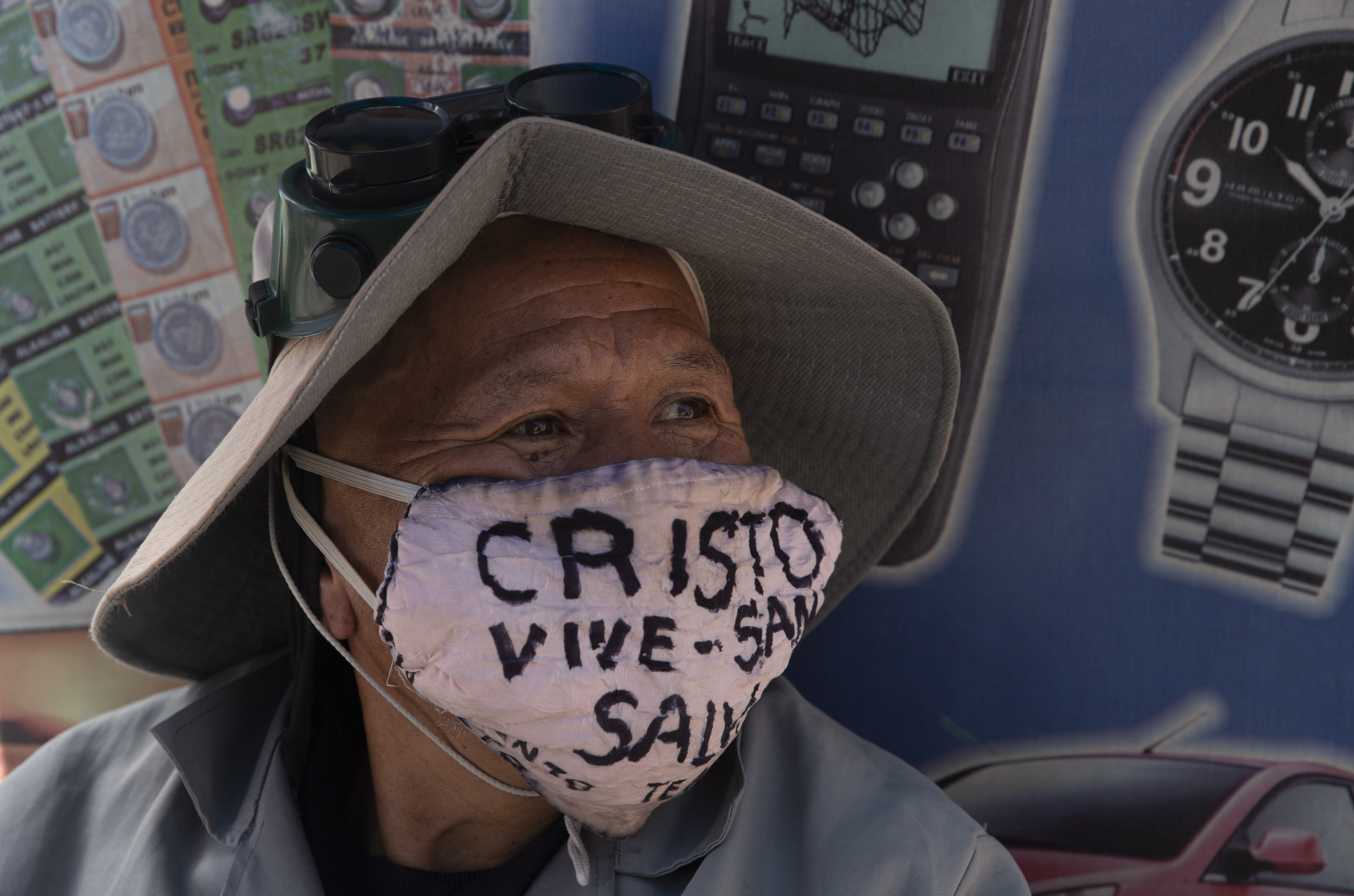 """A man wearing a protective face mask marked with a message that reads in Spanish: """"Christ lives, heals and saves,"""" in La Paz, Bolivia, Tuesday, July 21, 2020, amid the new coronavirus pandemic. (AP Photo/Juan Karita)"""