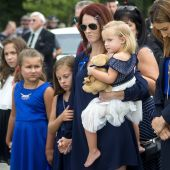 At slain officer's funeral, calls for respect and unity