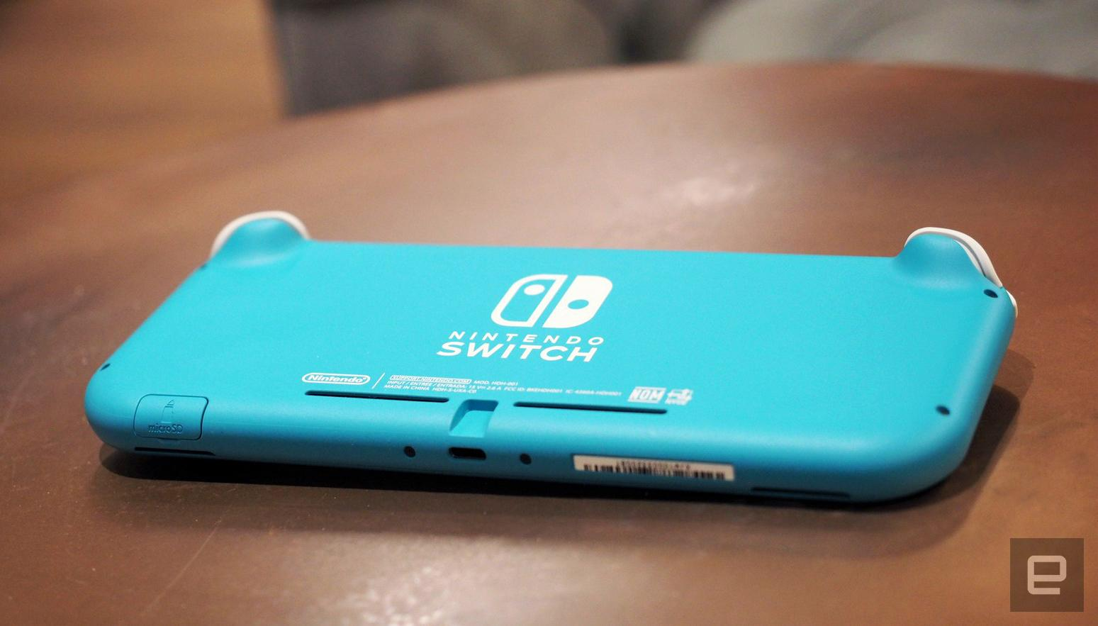 A light blue Nintendo Switch sits upside down on a coffee table.