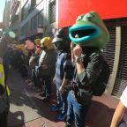 Hong Kong Protesters create huge human chains with animal masks