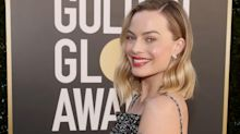 Margot Robbie Wore a Stunning Chanel Dress With a High-Leg Slit to the 2021 Golden Globes