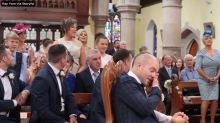 Wedding guests surprise bride and groom with touching performance of 'Stand by Me'