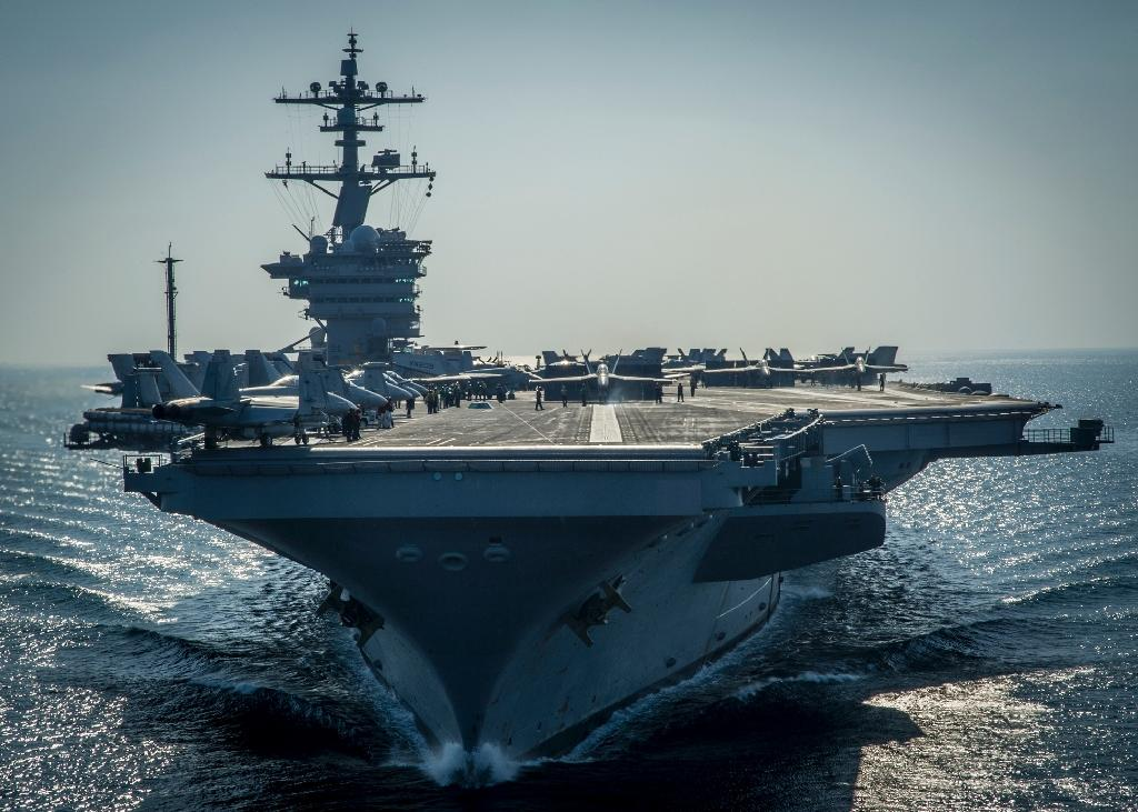 US President Donald Trump spoke with Japanese Prime Minister Shinzo Abe, discussing the joint drills under way between the US carrier Carl Vinson and Japan's Maritime Self-Defence Force (AFP Photo/ MC2 Scott Fenaroli)