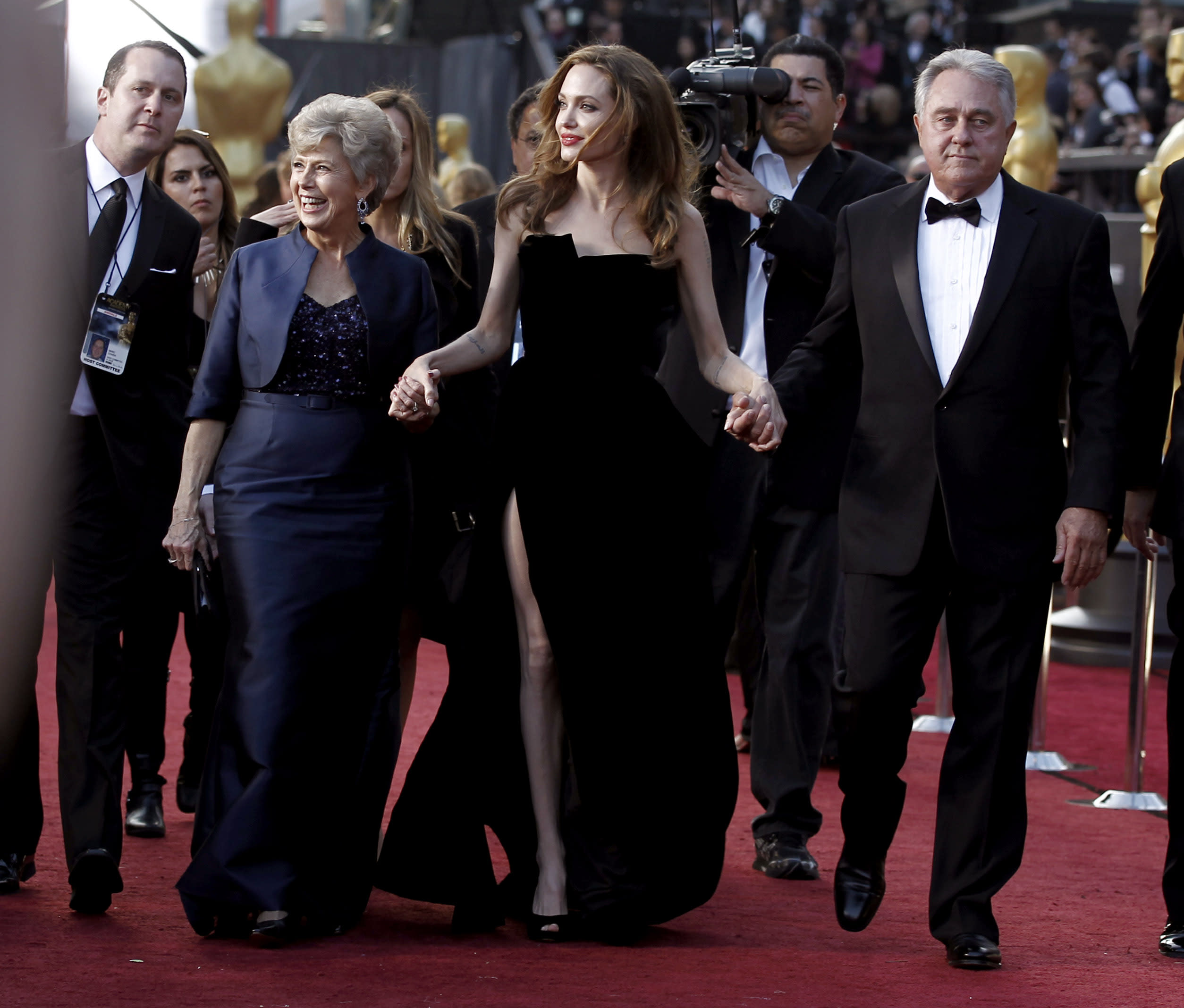 From left, Jane Pitt, Angelina Jolie and William Pitt arrive before the 84th Academy Awards on Sunday, Feb. 26, 2012, in the Hollywood section of Los Angeles. (AP Photo/Matt Sayles)