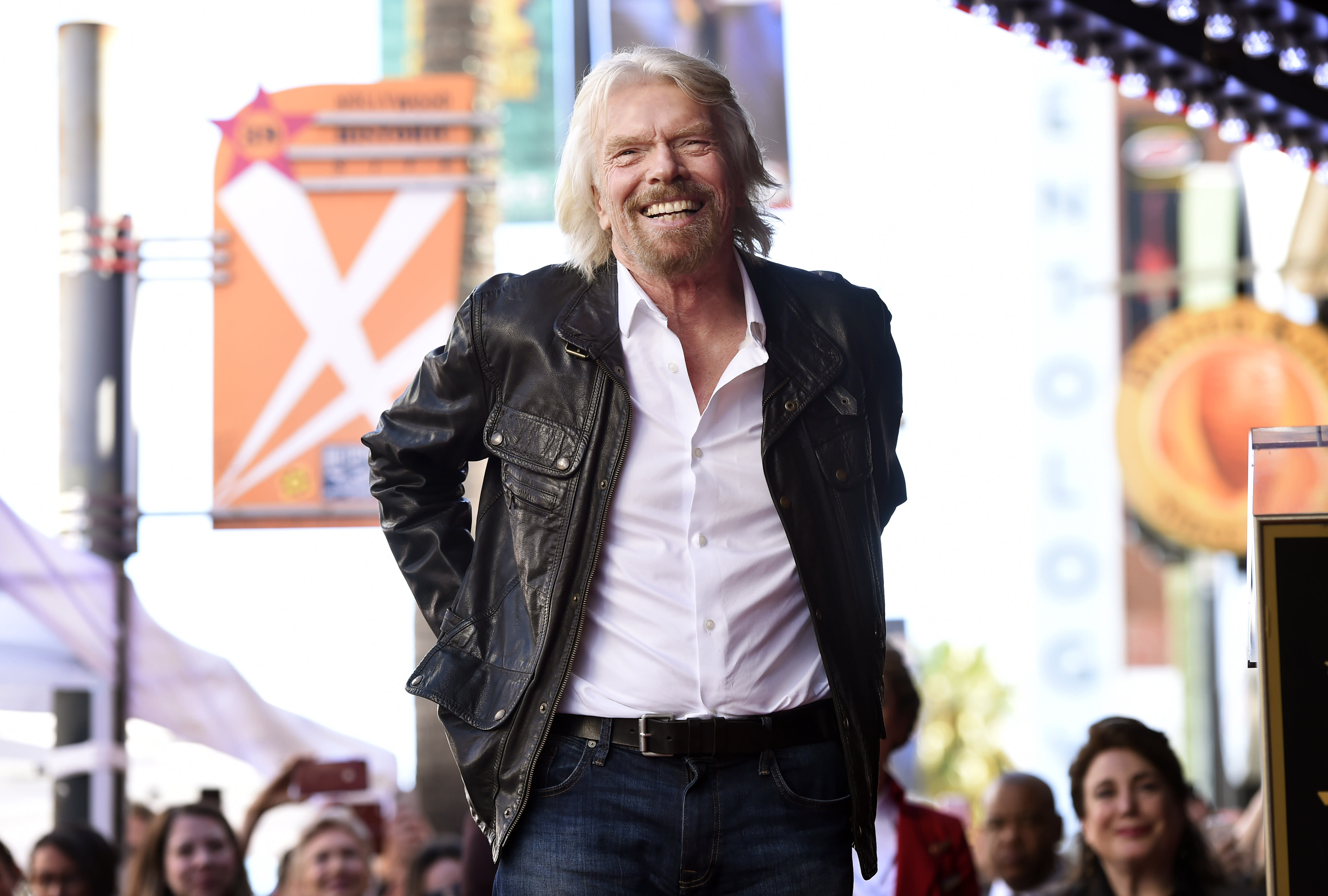"FILE - In this Oct. 16, 2018 file photo, British business magnate Richard Branson appears at a ceremony honoring him with a star on the Hollywood Walk of Fame, in Los Angeles. Branson said on Monday, Feb. 18, 2019, that he hopes that the concert that he is throwing for a humanitarian aid effort for Venezuela helps saves lives by raising funds for ""much-needed medical help."" (Photo by Chris Pizzello/Invision/AP File)"